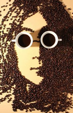 John Lennon created with 2 cups of coffee and coffee beans! Well done!
