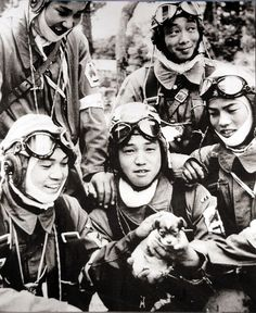 Kamikazes playing with a puppy, 1945.