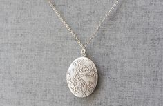 This gorgeous oval double side vine pattern locket long necklace made with silver burnish plated over brass pendant and chain,lobster clasp.  This graceful nacklace is perfect to wear during the day or a special night out. + The locket measures is approx. 23 mm * 30 + Total length measures 24 inches If you want different length, please simply leave a note to me when you order  Ive got gold version, to see gold version in my shop click here https://www.etsy.com/listing/7510...