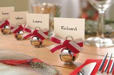 How much more festive can your dinner table get? Jingle Bells used as Place Card Holders from Grasslands Road. Christmas Place Cards, Christmas Names, Christmas Table Settings, Christmas Tablescapes, Christmas Table Decorations, Holiday Tables, Christmas Love, Christmas Wedding, Handmade Christmas