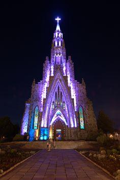 Nossa Senhora de Lourdes Cathedral glowing in the night, Canela, Brazil