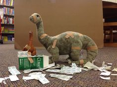 """Ouchy dinos. #LPLSDinovember is underway! Send us a picture of what dinosaurs do at your house overnight. The best entry will win a prize! You could win the movie """"Jurassic World"""" on DVD or """"Jurassic World: Where Dinosaurs Come to Life"""" book! Email your pictures to contest@lpls.info, post your photo to Lorain Public Library System's Facebook page, or tweet your picture at the library (@LorainLibrary). Include #LPLSDinovember. Good luck! #Dinovember2015"""