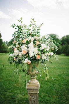 Elegant florals: http://www.stylemepretty.com/little-black-book-blog/2015/03/31/elegant-summer-estate-wedding/ | Photography: Michelle Gardella - http://www.michellegardella.com/