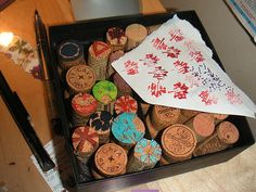 Make stamps out of your old wine corks! Only need an x-acto knife and ink.