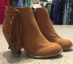 A close up of our newest arrival! Fringe booties! We are absolutely in love with them! heart emoticon Call the store or private message us to order! Only $49 smile emoticon #newarrival #booties #fringe #fall #fashion #favorite #musthave