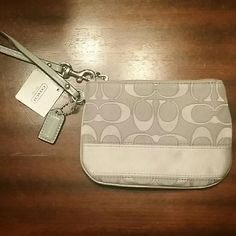 COACH wristlet. Brand new....never used Gray/silver wristlet Coach Bags Clutches & Wristlets