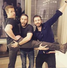 Chris and Scott Evans and another guy.