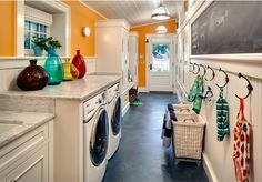 Cheery Laundry and Mud Room by Wade Weissmann Architecture. Check out the whole house!