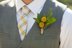 This is pretty much what I'm thinking for our alleged wedding - me in light grey, prol'ly with a vest, plaid tie and simple boutonniere.