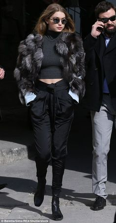 Top of the crop: They were wrapped up in chic winter coats on the Chanel catwalk but it appeared both Kendall Jenner and Gigi Hadid wanted to show off their toned stomachs on Tuesday morning