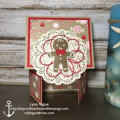 StampinUp Double Dutch Fold Christmas Card made with Cookie Cutter Christmas stamp set, Layering Circles Framelits, Candy Cane Lane DSP, Delicate White Doilies designed by demo Lynn Tague. See more cards and gift ideas at BeyondBeachesandBlessings.com #BeyondBeachesandBlessings