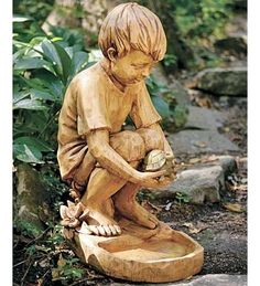 "Weatherproof Resin Boy With Turtle Birdfeeder by Wind & Weather®. $99.95. Boy with Turtle Birdfeeder. Made of weatherproof resin. Sculpted, wood look. 22-1/2""H x 16""W. There's nothing more precious than watching a child discovering nature's gifts. Celebrate that wonder every day with these realistic statuary designs. Sculpted of resin to look like wood, they can serve as birdbaths or feeders to attract your feathered friends."