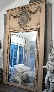 Could do this with oval pix frame, appliques and decorative molding.