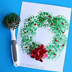 Make a fun christmas wreath craft using a dish brush from the kitchen! It's a easy christmas craft for kids to make.