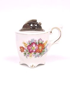 vintage cigarette lighter teacup. etsy.