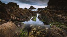 Pooled Rocks - A long exposure, landscape image of rock pools on the coastline of Portknockie in Moray, Scotland.