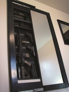 Tactical Walls Concealment Options. Hidden Spaces We Love at Design Connection, Inc. | Kansas City Interior Design http://designconnectioninc.com/ #HiddenRoom #GunSafe