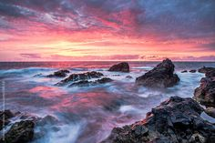 Dramatic Sunset over Wild Volcanic Coast by Andreas Wonisch