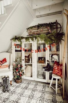 Ski lodge under the stairs! I felt so inspired to turn this nook under our stairs into a mini ski lodge. I wanted to mimic the style I would decorate the lodge Christmas Lodge, Merry Christmas, Vintage Christmas, Christmas Diy, Christmas Wreaths, Christmas Decorations, Modern Christmas, Purple Christmas, Scandinavian Christmas
