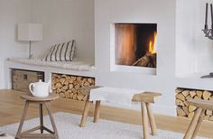 White fire place! Love the white bench on the side