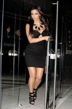 Kim Kardashian wearing Genevieve Jones Drawstring Bag with Metal Fringes Sena Cut-Out Dress in Black Givenchy Jersey Multi-Strap Sandals in Black Pamela Love Arrowhead necklace  Leaving Katsuya Restaurant in Hollywood May 10 2010