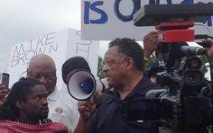 Jackson booed, man shot and Sharpton plans march in Missouri unrest
