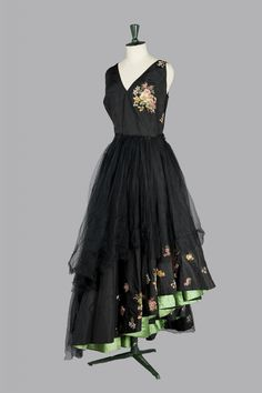 MARCEL ROCHAS Haute Couture, circa 1950 ... I love the peek-a boo under skirt in beautiful apple green. Beautiful contrast w/ the black on top.