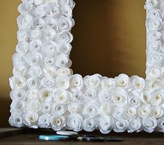 Make a cupcake liner rosette frame with #DIY from @savedbyloves