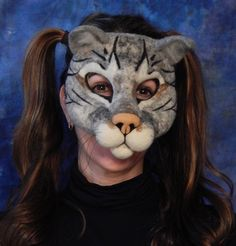"""Needle felted cat mask from the book """"Needle Felting Masks and Finger Puppets""""."""