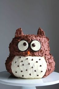 Owl Cake    Ingredients:    2 batches chocolate devils food cake  3 sticks unsalted butter, soften  1 cup confectioners sugar  1/2 cup cocoa powder  3/4 cup Nutella  2 tablespoons heavy cream  2 Oreo cookies  2 brown or black M  1 piece of orange rind  1 tablespoon small chocolate chips
