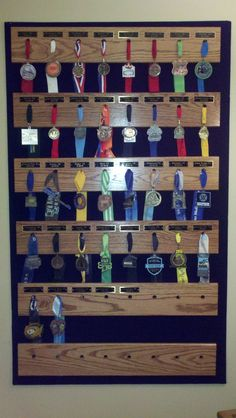 Wonder if you could adapt this for non state race medals. Cool way to display medals Fifty 50 State Half Marathon Club Photos http://www.halfmarathonclub.com