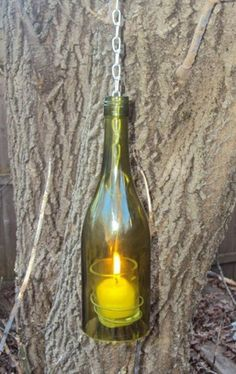 Hanging wine bottle candle holder | NorthshoreCandles - Candles on ArtFire - similar?