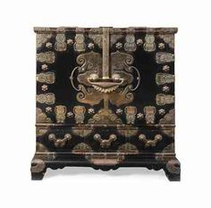 A KOREAN BRASS-MOUNTED EBONISED TEMPLE CABINET-ON-STAND
