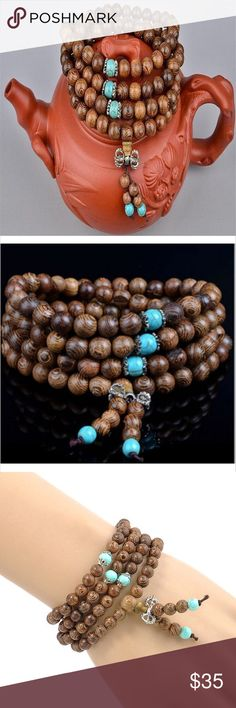 """Buddhist 108 Sandalwood Mala Beads Necklace Can be worn as necklace, wrapped 4 times for bracelet or mantra prayer beads. 108 sandalwood beads with turquoise bead spacers and dorje on end. Spiritual Buddha yoga pagan eastern Tibet Tibetan India Nepal. 27"""" long. 🌟 Bundle to Save the most. 25% OFF Bundles of 2 or More items. I accept reasonable offers & bundle offers. No holds, trades, or lowball offers. Boutique Jewelry Necklaces"""