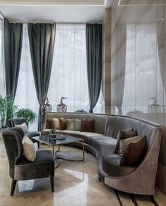 Wonderful velvet conversational couch. Floor to ceiling windows. Marble floors.  Project:International Plaza Location:Changsha