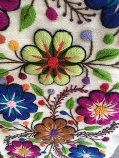 Soft alpaca runner embroidered with graceful flowers and leafs, finished with multicolored tassels. Gorgeous at your dinner table or as a bed runner. The
