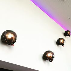 Moxy Milan lobby design by APTO. ------- In a rad hotel in Italy. Complete with helmet lights in the lobby. #motorcycle #moxyhotels #summer #atthemoxy