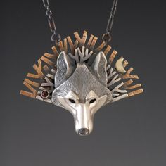 Lone Wolf handcrafted silver Native American pendant.