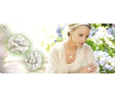 £10.00 Avon Clair Set. A beautiful cream flower shaped pendant combined with silver plated necklace.  42cm x 9cm  With matching adjustable ring. BUY SEPARATELY FOR 6.00 EACH