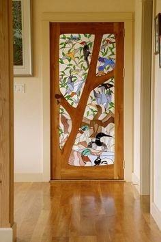 Eclectic Entryway with Stained glass door, Brenco Exotic Woods African Celtis Natural Medium Hardwood Flooring
