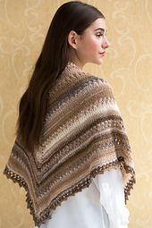 This simple shawl features eyelet rows and an elegant picot bind-off. Self-striping NAVAJO provides the visual interest.