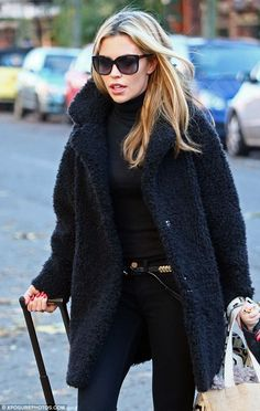 Abbey Clancy.. black, snug and classy.. belt detail..