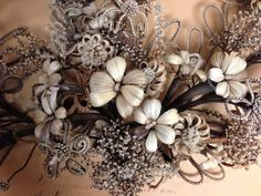 The docent at Leila's museum stresses to me that the collection I'm looking at isn't about death, but her words are less than convincing. For one thing, I suspect that all… Dishwater Blonde, Hair Wreaths, Hair Rings, Front Rooms, Love Hair, Hair Art, Flower Making, Macabre, Christmas Wreaths
