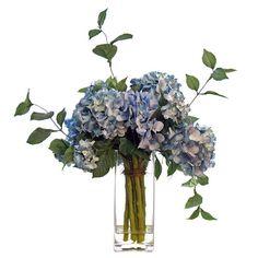 Faux hydrangea arrangement in glass vase.  Product: Faux floral arrangementConstruction Material: Silk, plastic and g...