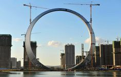 """Saturday Fun: A circle-shaped piece of landscape architecture in Fushun, Liaoning province China. The high building named """"Ring of Life"""" cost. Stargate, Tour Eiffel, Amazing Architecture, Landscape Architecture, China Architecture, Futuristic Architecture, Monuments, High Building, Circle Of Life"""