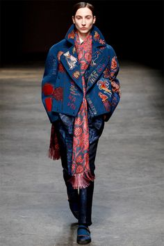 [E. Tautz]: all-star piece -- note the embroidery. These designs were seen on a few of the finale looks. Also note the long, printed scarf and printed trousers.