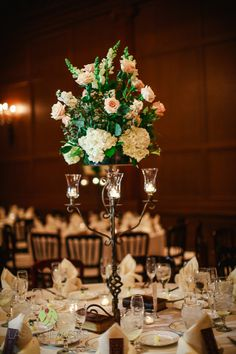 Iron candelabra centerpiece with pink roses and white hydrangea & snapdragons | Lasting Images Photography | villasiena.cc