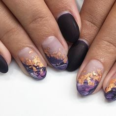 Cool accent nail using diagonal negative space and gold flakes.