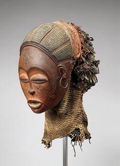 Pwo mask Date: 19th century Geography: Angola Culture: Chokwe peoples Medium: Wood, fiber, pigment