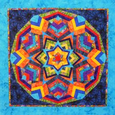 Made by Wendy Mathson. Based on Ricky Tims' Kaleidoscope Quilts book. This was a group challenge using the multicolor butterfly fabric.
